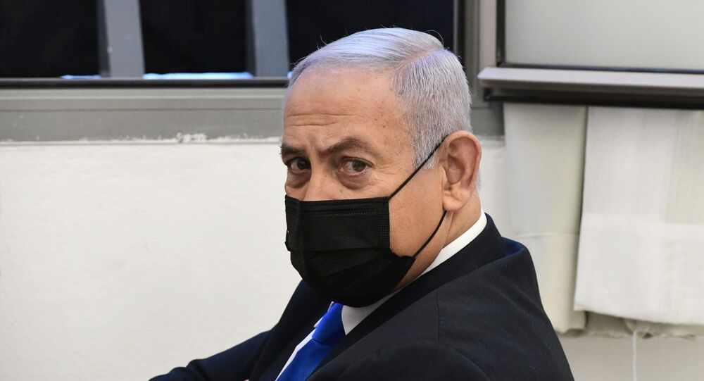 Israeli Prime Minister Benjamin Netanyahu looks on before the start of a hearing in his corruption trial at Jerusalem's District Court, 8 February 2021.