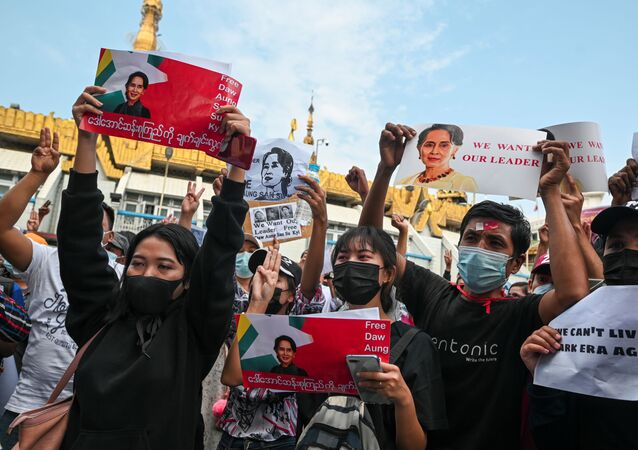 People hold placards depicting elected leader Aung San Suu Kyi during a rally to demand her release and protest against the military coup, in Yangon, Myanmar, February 8, 2021