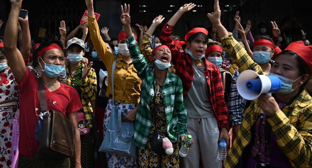 Protesters hold up the three finger salute during a demonstration against the military coup in Yangon on February 6, 2021. (Photo by YE AUNG THU / AFP)