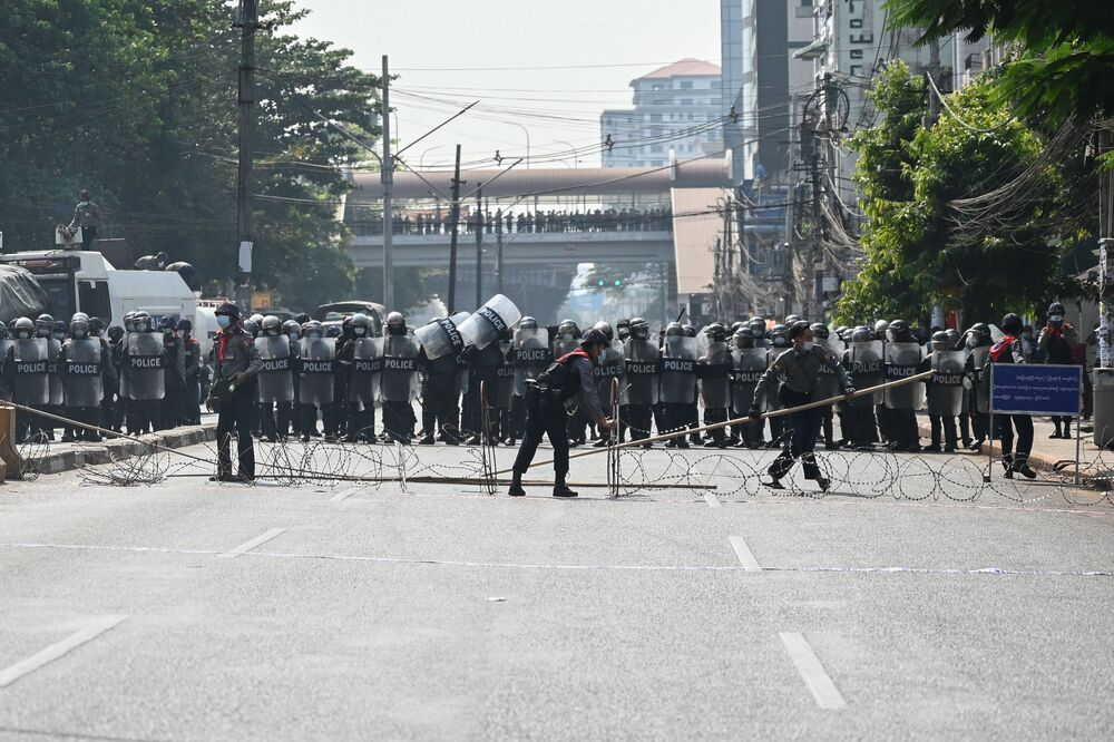 Riot police block off a street as protesters gather for a demonstration against the military coup in Yangon on 6 February 2021.