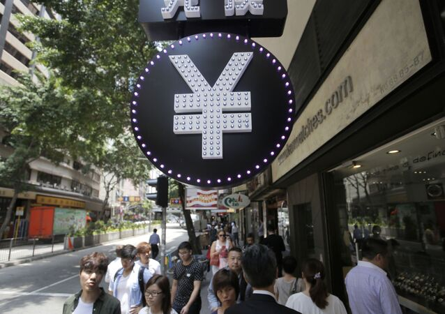 A Chinese yuan sign is seen at a currency exchange shop in Hong Kong, Tuesday, Aug. 11, 2015. China devalued its tightly controlled currency Tuesday following a slump in trade, allowing the yuan's biggest one-day decline in a decade. (AP Photo/Vincent Yu)