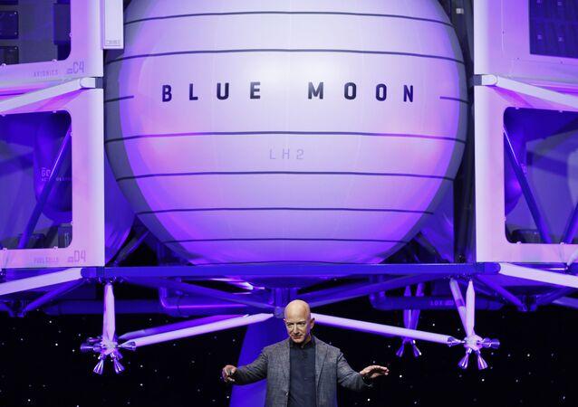 Jeff Bezos speaks in front of a model of Blue Origin's Blue Moon lunar lander, Thursday, May 9, 2019, in Washington