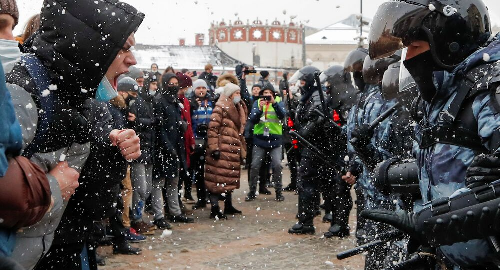 Protestors face off law enforcement officers during a rally in support of Alexei Navalny in Moscow, Russia January 31, 2021.