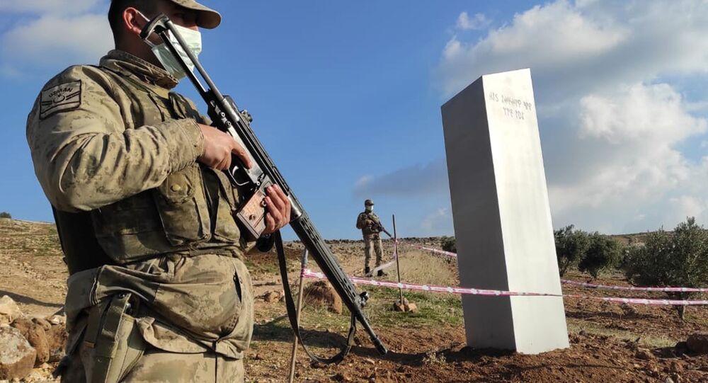 Turkish police officers guard a monolith, found on an open field near Sanliurfa, southeastern Turkey, Sunday, Feb. 7, 2021.