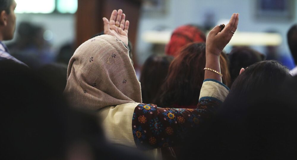 In this Sunday, Jan. 20, 2019 photo, a woman prays during Mass at St. Mary's Catholic Church in Dubai, United Arab Emirates. The Catholic Church's parishioners in the UAE come from around the world and will offer an international welcome to Pope Francis Feb. 3 through Feb. 5, that marks the first ever papal visit to the Arabian Peninsula, the birthplace of Islam. The Catholic Church believes there are some 1 million Catholics in the UAE today.