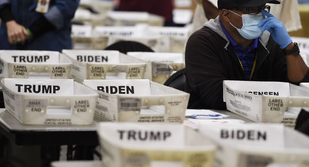 Cobb County Election official sort ballots during an audit, Friday, Nov. 13, 2020, in Marietta, Ga.