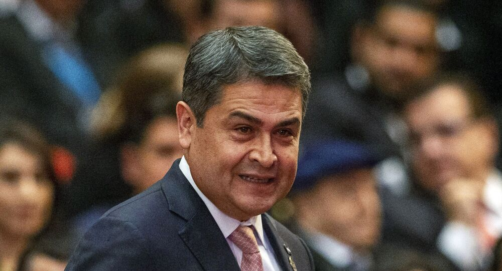 FILE - In this Jan. 14, 2020, file photo, Honduras' President Juan Orlando Hernandez arrives for the swearing-in ceremony for Guatemala's new President Alejandro Giammattei at the National Theater in Guatemala City. The Honduras president announced in June that he had tested positive, along with two other people who worked closely with him. (AP Photo/Moises Castillo, File)