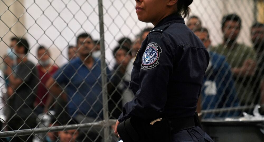 A U.S. Customs and Border Protection agent monitors single-adult male detainees at Border Patrol station in McAllen, Texas