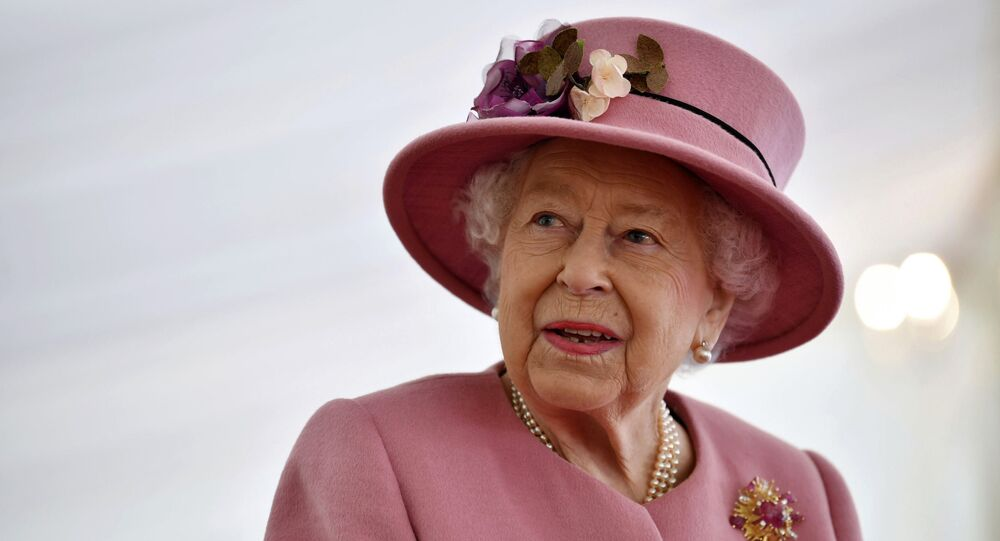 Britain's Queen Elizabeth II visits the Defence Science and Technology Laboratory (DSTL) at Porton Down, England, Thursday Oct. 15, 2020, to view the Energetics Enclosure and display of weaponry and tactics used in counter intelligence