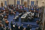 In this image from video, Sen. Patrick Leahy, D-Vt., the president pro tempore of the Senate, who is presiding over the impeachment trial of former President Donald Trump, swears in members of the Senate for the impeachment trial at the U.S. Capitol in Washington, Tuesday, Jan. 26, 2021