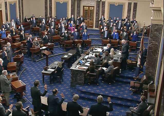 In this image from the video, Democrat Senator for Vermont Patrick Leahy, president for the time being of the Senate who is presiding over the impeachment trial of former President Donald Trump, swears in members of the Senate for the impeachment trial at the US Capitol in Washington, Tuesday, 26 January 2021.