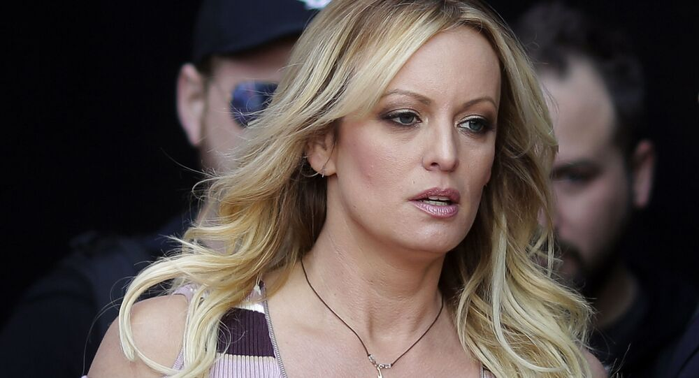 In this Oct. 11, 2018, file photo, adult film actress Stormy Daniels arrives for the opening of the adult entertainment fair Venus in Berlin