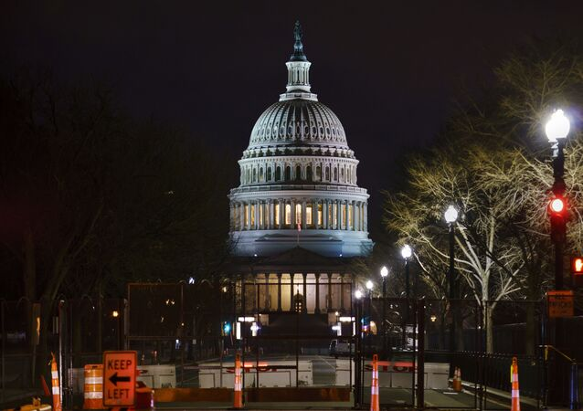 The Capitol is seen behind reinforced barricades as the second impeachment trial of former President Donald Trump begins in the Senate in Washington, Tuesday, Feb. 9, 2021.