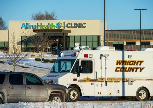 A Wright County Sheriff vehicle is seen parked outside the Allina Health Clinic in Buffalo, Minnesota, after a shooting there left at least five wounded on February 9, 2021.