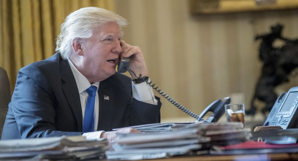 President Donald Trump speaks on the phone with Russian President Vladimir Putin, 28 January 2017, in the Oval Office