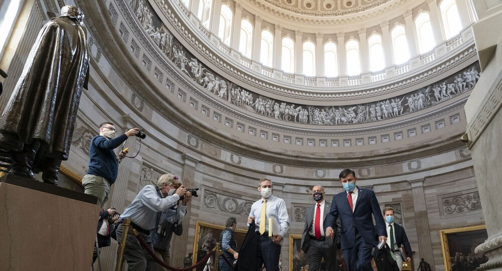 Rep. Jim Jordan, R-Ohio, left, and others walk through the Rotunda to the Senate for the second impeachment trial of former President Donald Trump, Tuesday, Feb. 9, 2021, in Washington.