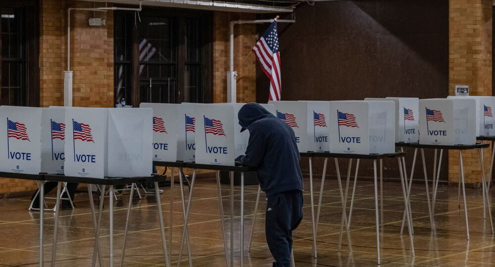 A resident casts his vote on November 3, 2020, at Berston Fieldhouse in Flint, Michigan.