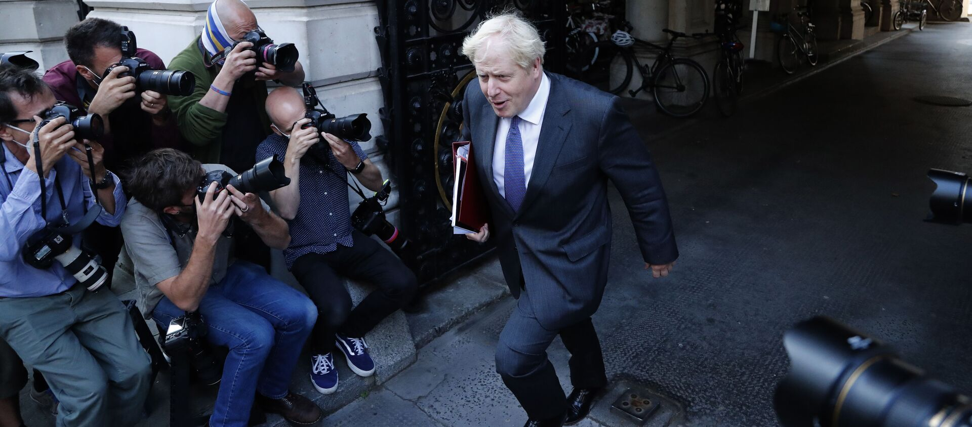 Britain's Prime Minister Boris Johnson walks past media photographers to his office in Downing Street after a cabinet meeting in London, Tuesday, Sept. 15, 2020. - Sputnik International, 1920