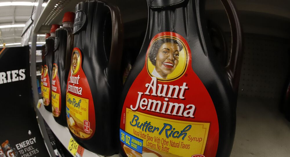 Bottles of Aunt Jemima Original Syrup are displayed on a shelf in a Walmart in Pittsburgh, Sunday, June 21, 2020. (AP Photo/Gene J. Puskar)