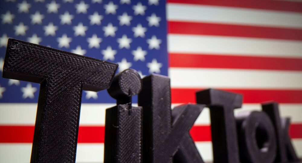 A 3D printed Tik Tok logo is seen in front of U.S. flag in this illustration taken October 6, 2020. Picture taken October 6, 2020.