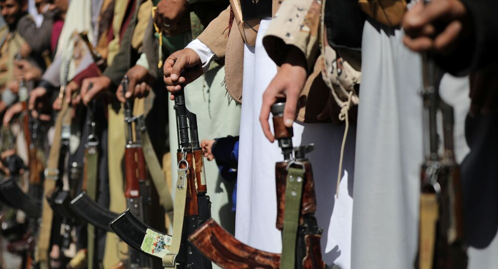 Houthi supporters hold their weapons during a demonstration outside the U.S. embassy against the United States over its decision to designate the Houthis a foreign terrorist organisation, in Sanaa, Yemen January 18, 2021