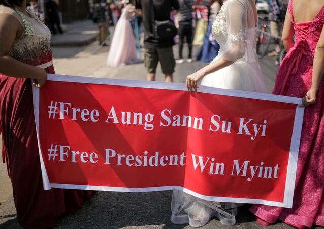 Women wearing ball gowns protest against the military coup and to demand the release of elected leader Aung San Suu Kyi in Yangon, Myanmar February 10, 2021. in this still image obtained from social media