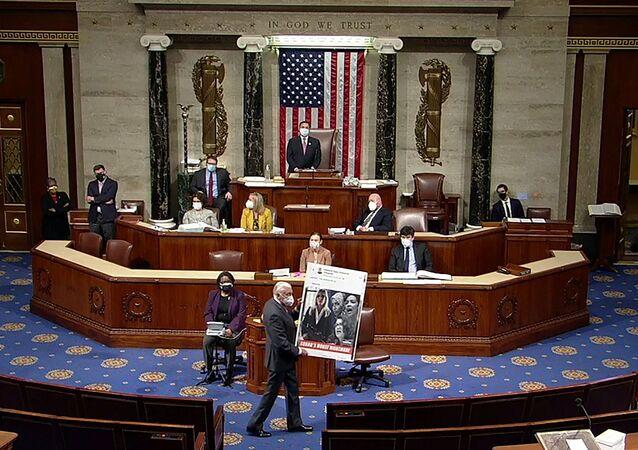 U.S. House Majority Leader Steny Hoyer (D-MD) carries an enlarged Tweet