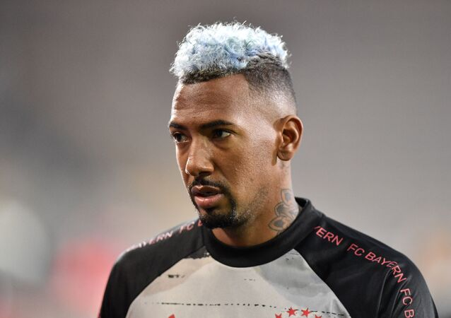 Bayern's Jerome Boateng walks on the pitch before the German Bundesliga soccer match between Arminia Bielefeld and Bayern Munich.