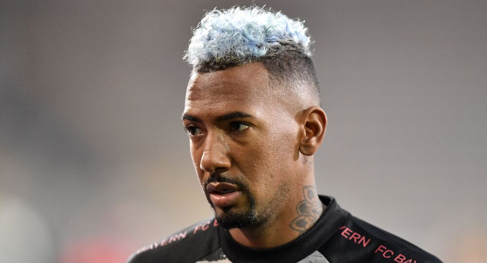 Bayern Munich's Jerome Boateng walks on the pitch before the German Bundesliga soccer match between his team and Arminia Bielefeld.
