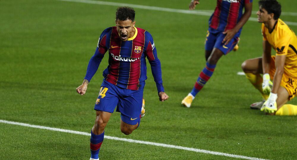 Barcelona's Philippe Coutinho celebrates scoring the opening goal during the Spanish La Liga soccer match