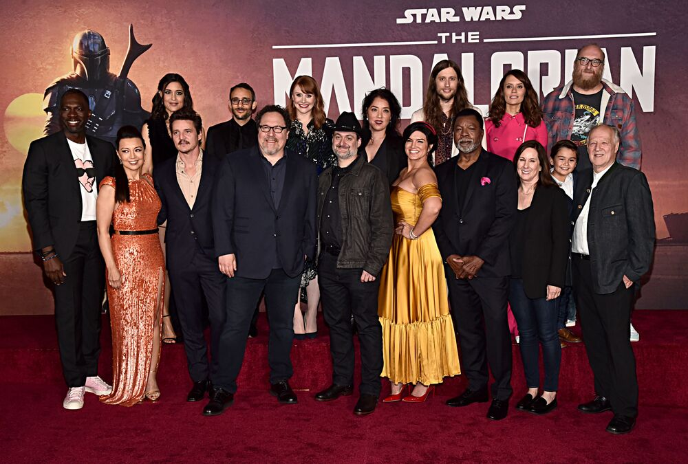 (Back L-R) Rick Famuyiwa, Julia Jones, Omid Abtahi, Director Bryce Dallas Howard, Director Deborah Chow, Composer Ludwig Goransson, Emily Swallow, Brian Posehn, (Front L-R) Ming-Na Wen, Pedro Pascal, Executive Producer Jon Favreau, Executive Producer/Director Dave Filoni, Gina Carano, Carl Weathers, Executive Producer Kathleen Kennedy, Aidan Bertola and Werner Herzog arrive at the premiere of Lucasfilm's first-ever, live-action series, The Mandalorian, at El Capitan Theatre in Hollywood, Calif, on 13 November 2019.