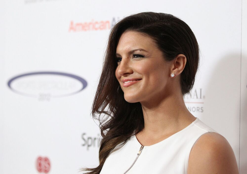 MMA fighter Gina Carano arrives at the 27th Anniversary Sports Spectacular benefiting Cedars-Sinai Medical Genetics Institute at the Hyatt Regency Century Plaza on 20 May 2012 in Century City, California.