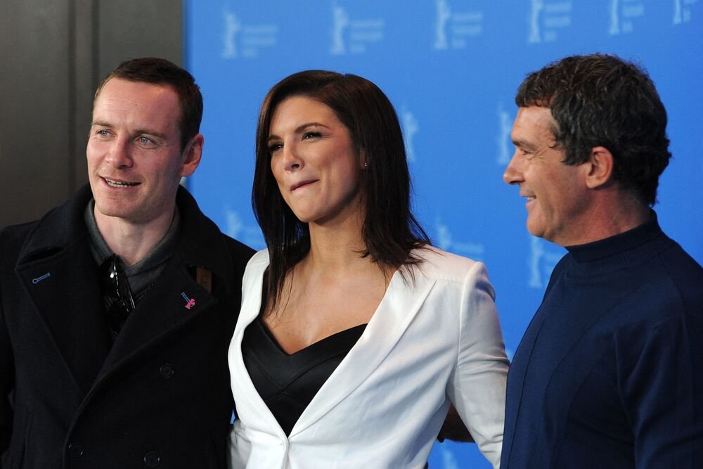 Irish-German actor Michael Fassbender, US actress Gina Carano and Spanish actor Antonio Banderas pose for photographers during a photocall to present the film Haywire at the Berlinale film festival on 15 February 2012 in Berlin.