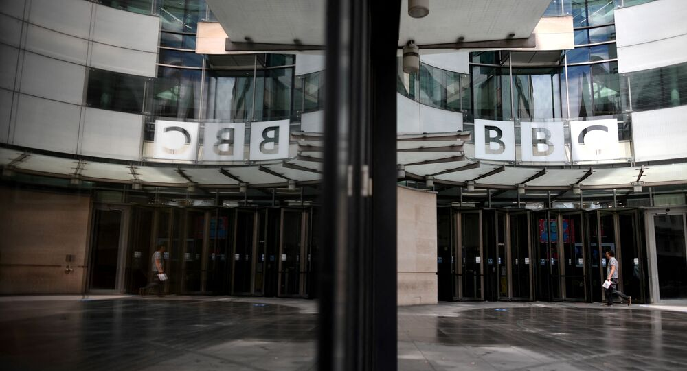 A man walks outside the BBC headquarters in Portland Place, London on July 2, 2020