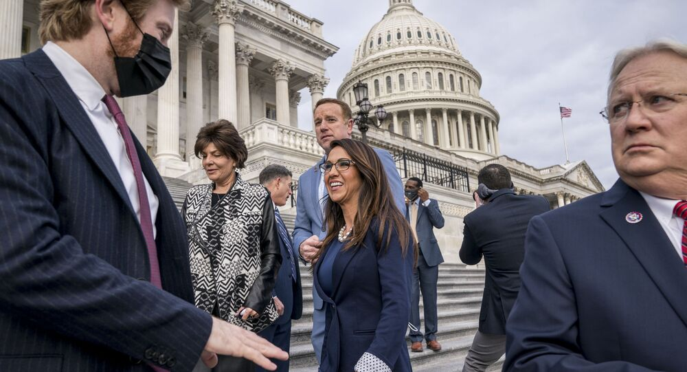 Rep. Lauren Boebert, R-Colo., centre, smiles after joining other freshman Republican House members for a group photo at the Capitol in Washington, Monday, 4 January 2021. Rep. Jerry Carl, R-Ala., is at right.