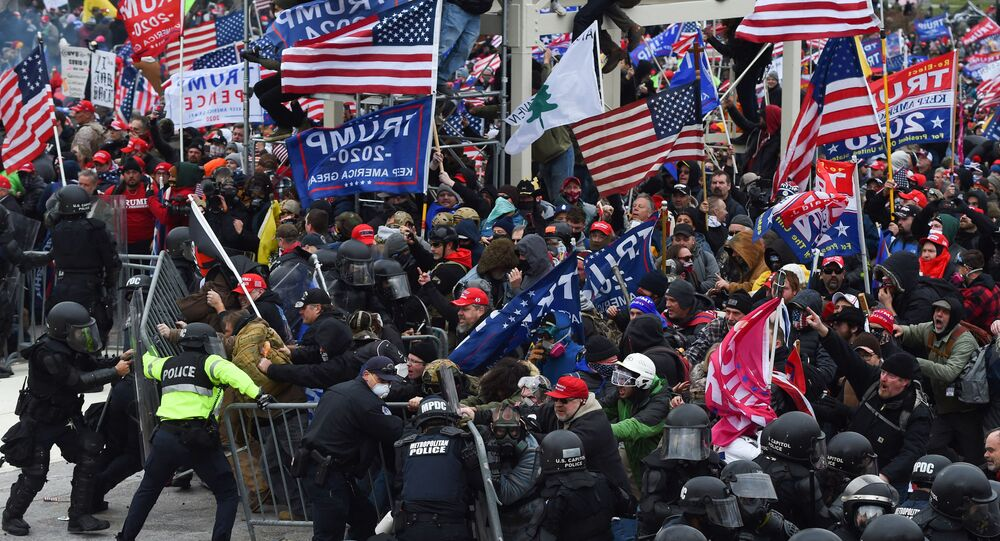 In this file photo taken on January 06, 2021 Trump supporters clash with police and security forces as they push barricades to storm the US Capitol in Washington D.C. - Impeachment prosecutors aired terrifying, never-before-seen footage of senior US politicians fleeing for their lives during the January assault on Congress by Donald Trump supporters on day two of the former president's Senate trial. With painstaking, graphic presentations, Democratic impeachment managers walked senators through hours of video, some of which came from security cameras and police bodycams and was being aired for the first time.
