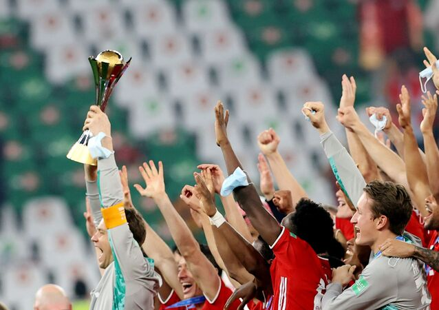 Bayern Munich players celebrate with the Club World Cup trophy