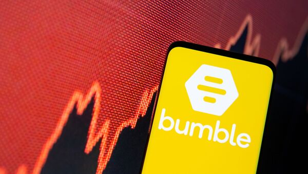 The Bumble logo is seen on a smartphone in front of a stock graph in this illustration taken February 11, 2021 - Sputnik International