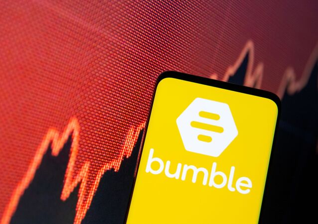 The Bumble logo is seen on a smartphone in front of a stock graph in this illustration taken February 11, 2021