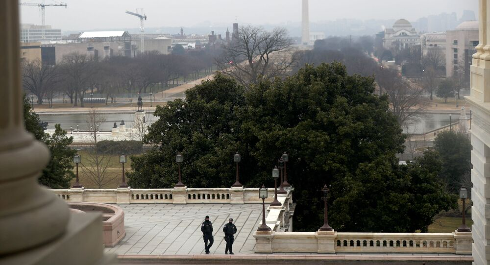 U.S. Capitol officers walk during the third day of senate impeachment hearings against former U.S. President Donald Trump, at the U.S. Capitol