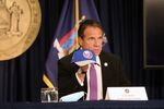 SEPTEMBER 08: New York state Gov. Andrew Cuomo holds an NHL New York Islanders hat at a news conference on September 08, 2020 in New York City. Cuomo, though easing restrictions on casinos and malls throughout the state, has declined to do so for indoor dining in restaurants in New York City despite pressure from business owners, citing struggles by the city to enforce the state's previous orders.