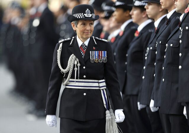Britain's Metropolitan Police Commissioner Cressida Dick inspects police cadets at the Metropolitan Police Service Passing Out Parade at Hendon, in London, Friday Nov. 3, 2017