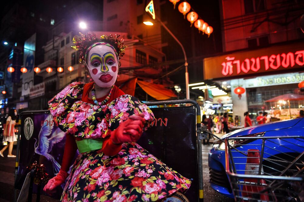 A dancer performs in Chinatown in Bangkok on 11 February 2021, ahead of the start of the Lunar New Year, which ushers in the Year of the Ox on 12 February.