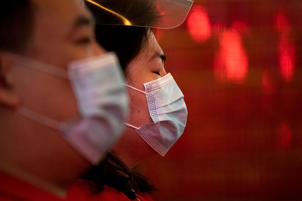 People wearing masks for protection against the coronavirus disease pray inside a temple in Chinatown during Lunar New Year in Manila, Philippines, 12 February 2021.