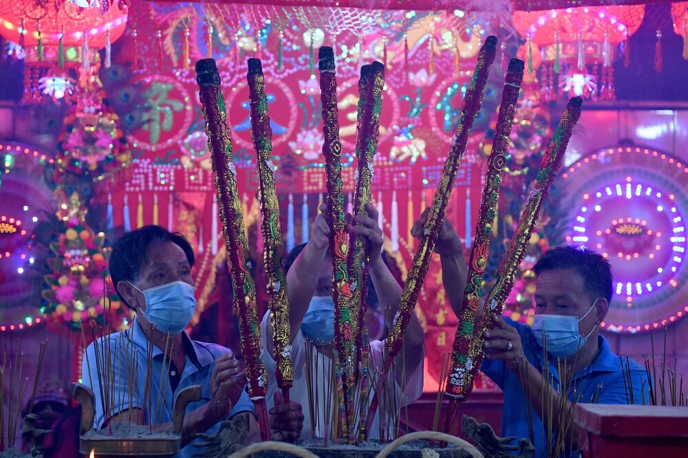 Devotees offer incense sticks at a temple to mark the start of the Lunar New Year in Ta Khmao, Kandal province on 12 February 2021.