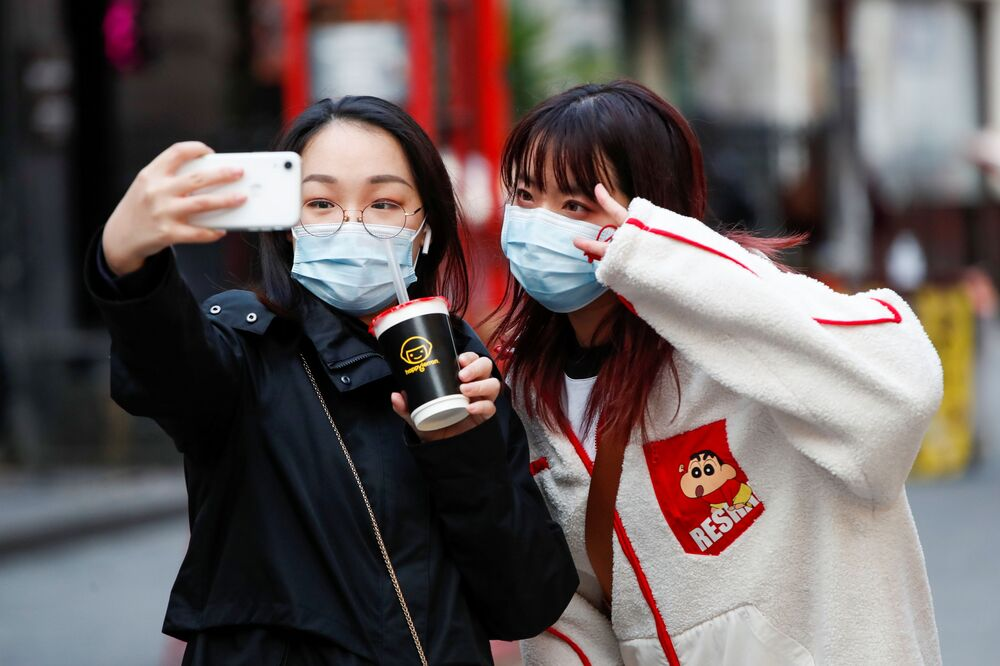 People take a selfie as China Town prepares for Chinese Lunar New Year, in London, Britain 11 February 2021.