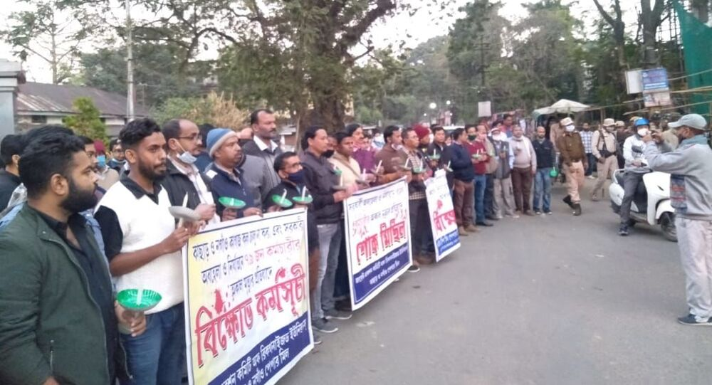 Mills workers protest across the Indian state of Assam.