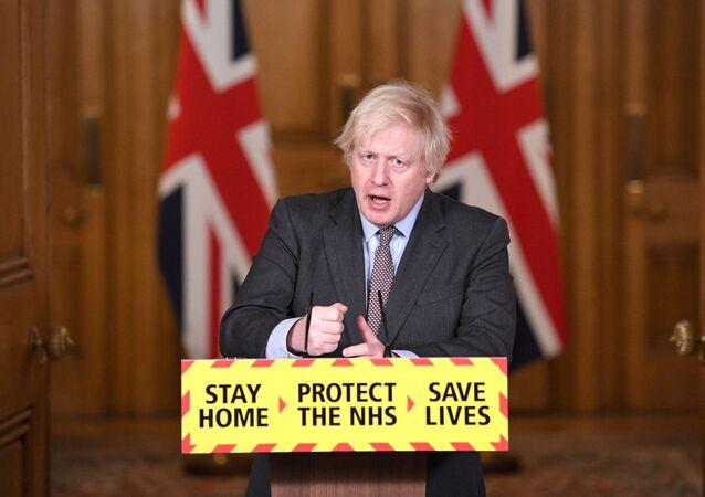 Britain's Prime Minister Boris Johnson addressees the media at a coronavirus disease (COVID-19) pandemic briefing in Downing Street, London, Britain February 3, 2021.