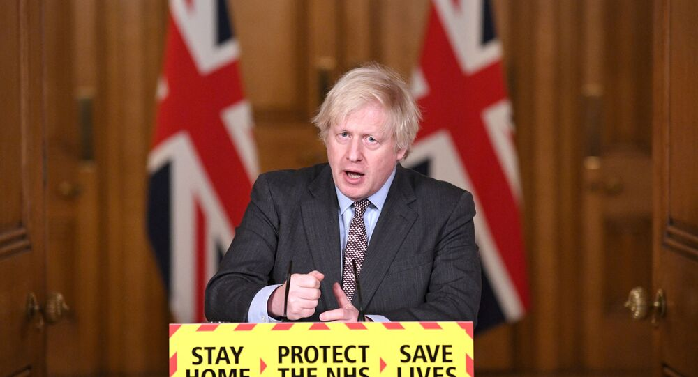 Britain's Prime Minister Boris Johnson addressees the media at a coronavirus disease (COVID-19) pandemic briefing in Downing Street, London, Britain February 3, 2021.