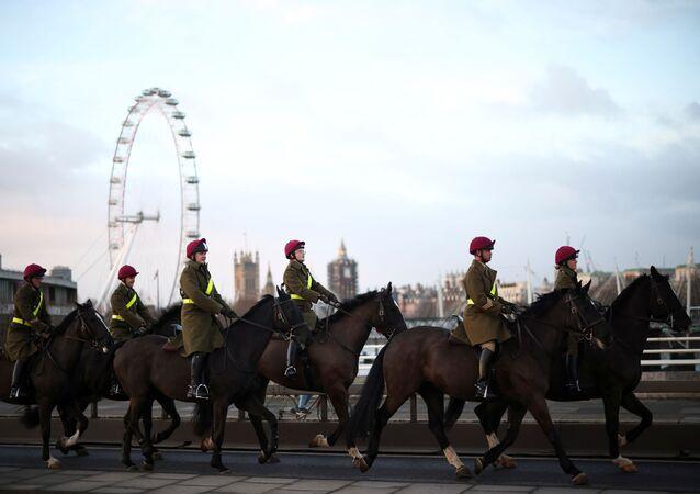 Mounted members of the military travel across Waterloo Bridge, amid the coronavirus disease (COVID-19) outbreak in London, Britain, 29 January 2021. REUTERS/Henry Nicholls